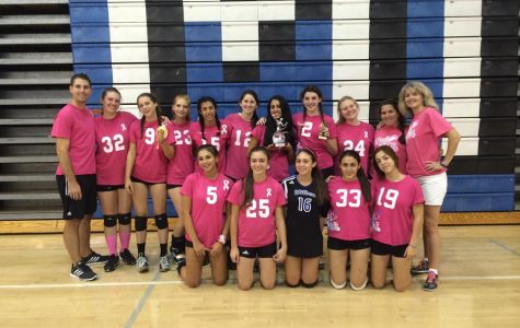 Solomon is standing in the top middle holding a silver trophy, Cohen is to her left holding a gold trophy at the Varsity Dig Pink Tournament.