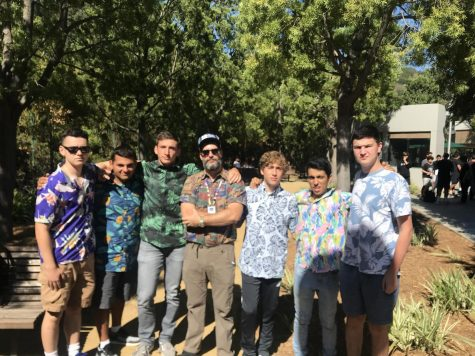 Rabbi David and students pose for a photo during a Hawaiian-themed 2.0neg.