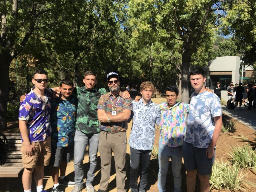 Rabbi David and students pose for a photo during a Hawaiian-themed 2.0neg.