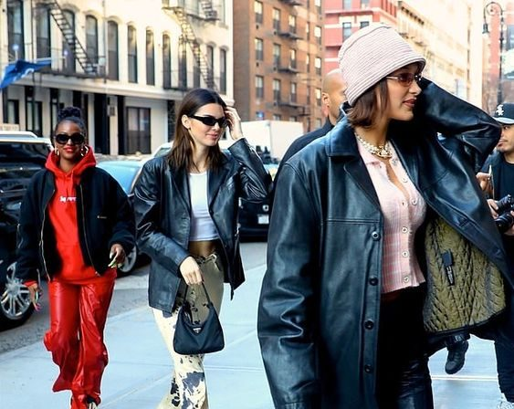 Models are photographed out in NYC during winter wearing trendy outfits